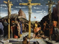 Roman soldiers play a game, in front of the crosses. Mourning women.